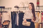 stock photo of showrooms  - Fashionable young woman in a fashion showroom - JPG