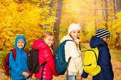 Back view of happy children wearing rucksacks