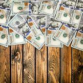 big pile of money. 100 new dollars over white background
