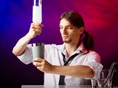 stock photo of over counter  - Young stylish man bartender preparing serving alcohol cocktail drink over bar counter - JPG