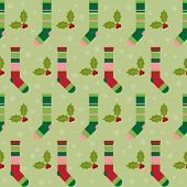 Winter Holidays Pattern Background With Colorful Baby Socks For Gifts From Santa Claus And  Branch O