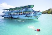 Trat Thailand - Oct29 : Visitor Boat And Traveler Snorkeling And Enjoy Activities On Blue Clear Wate