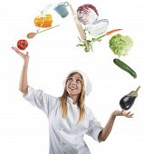 stock photo of juggler  - Juggler chef play with some ingredients and kitchen tools - JPG