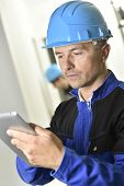 Supervisor on construction site using tablet