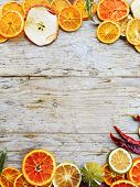 stock photo of dry fruit  - Dried fruit and spices on wooden background - JPG