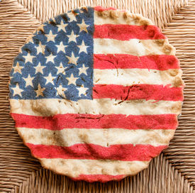 stock photo of superimpose  - American flag superimposed on apple pie with straw background - JPG