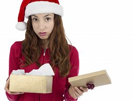 pic of sad christmas  - Caucasian christmas woman looking unhappy with her christmas gift - JPG