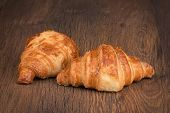 picture of croissant  - fresh baked croissant on a wooden background - JPG