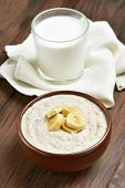 picture of porridge  - Oatmeal porridge with banana slices and glass of milk - JPG