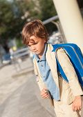 image of schoolboys  - Portrait of serious schoolboy with backpack outdoor - JPG