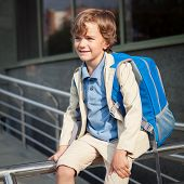 stock photo of schoolboys  - Portrait of happy schoolboy with backpack outdoor - JPG