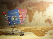 stock photo of citizenship  - Passports in shopping cart with DOF effect - JPG