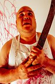 stock photo of insane  - Crazy insane butcher covered with blood - JPG