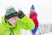 picture of snowball-fight  - Young friends having snowball fight - JPG