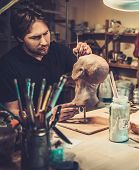 picture of prosthetics  - Man working in a prosthetic special fx workshop - JPG