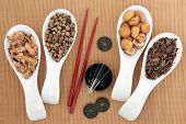 stock photo of bamboo  - Acupuncture needles and chinese herbal medicine selection with chopsticks and I ching coins over bamboo background - JPG