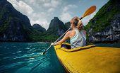 pic of kayak  - Woman exploring calm tropical bay with limestone mountains by kayak - JPG