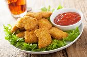 stock photo of fried chicken  - fast food chicken nuggets with ketchup - JPG