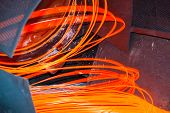 stock photo of manufacturing  - manufacturing wire Steel Works brown orange fire - JPG