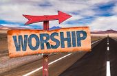 stock photo of worship  - Worship sign with road background - JPG