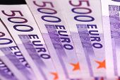 picture of payday  - Five hundred Euro banknotes on black background - JPG