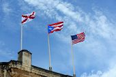 stock photo of san juan puerto rico  - Flags fly at Castillo de San Cristobal - JPG