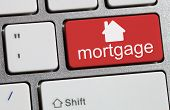 stock photo of borrower  - Keyboard with single red button showing the word mortgage - JPG
