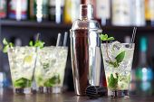 pic of mojito  - Four Mojito cocktails on a bar counter in a night club - JPG