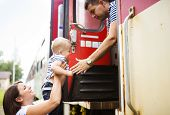 foto of passenger train  - Family with a son travel entering the train - JPG