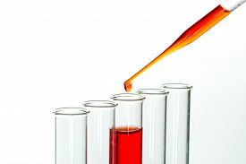 stock photo of tubes  - Test tubes and pipette drop Laboratory Glassware for chemical research - JPG