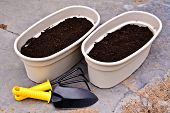 Two Planters And Garden Tools