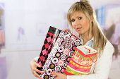 Portrait of an attractive young woman with shoppingbags