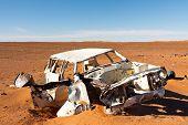 Abandoned Wrecked Car In Desert