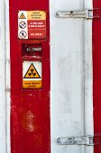 Closed Door Of A Nuclear Facility With Signs On It