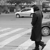 a old man walking in winter