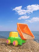 Child Toy Car On The Beach poster