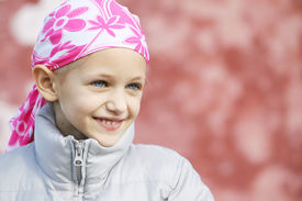 image of chemotherapy  - beautiful caucasian girl wearing a head scarf due to hair loss from chemotherapy fighting cancer - JPG