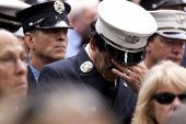 NEW YORK - SEPT 11: Firefighters attend a ceremony at the Firefighters Memorial on September 11, 201