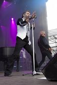 CLARK, NJ - SEPT 17: Singer/songwriter Paul Rodgers performs at the Union County Music Fest on September 17, 2011 in Clark, NJ. He formed and led the bands Free and  Bad Company to worldwide success.