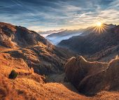 Mountains In Fog At Beautiful Sunset In Autumn. Dolomites, Italy. Landscape With Alpine Mountain Val poster