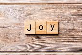 Joy Word Written On Wood Block. Joy Text On Wooden Table For Your Desing, Concept poster