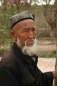 A Uyghur man from Kashgar, China, at an animal market