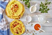Naan - Delicious Hot Freshly Baked Homemade Indian Flatbread On A White Table With Ingredients And S poster