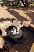 picture of dutch oven  - Dinner cooking in a dutch oven in an outdoor fire pit - JPG