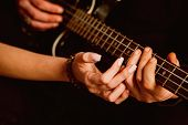 We Love Music. Couple In Love Play Duets. Male And Female Hands Play The Electric Guitar. Couple Of  poster