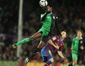 BARCELONA - FEB 20: P. Diop (L) of Santander and Iniesta (R) of Barcelona during Spanish league matc