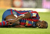 BARCELONA- APR 3: Toure Yaya of Barcelona injured during a Spanish League match between FC Barcelona