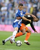 BARCELONA, SPAIN-MAY 1: Luis Garcia(L) of Espanyol fight with Fernandes(R) of Valencia during the Spanish League match Espanyol vs Valencia at the Estadi Cornella on May 1, 2010 in Barcelona, Spain