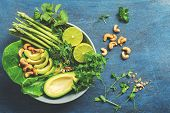 A Bowl Of Green Vegan Salad With Asparagus, Avocado, Lettuce, Basil, Mint, Microgreen, Lime And Cash poster