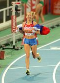 BARCELONA, SPAIN - JULY 28: Inga Abitova of Russia celebrates the Women 10000m silver medal during t